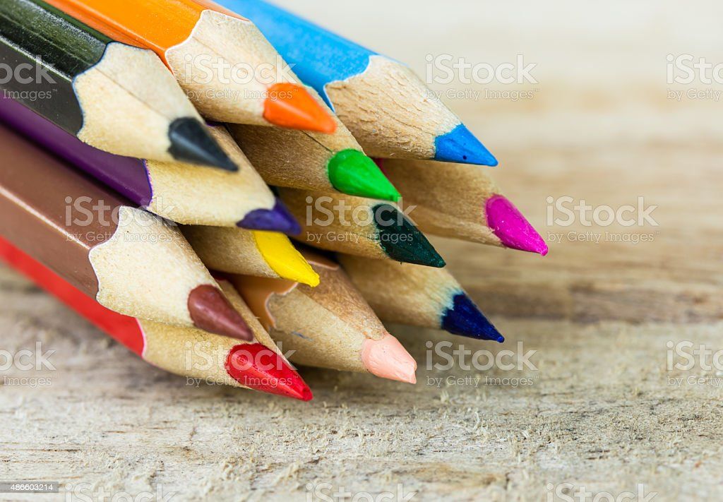 Color pencils on wood background stock photo