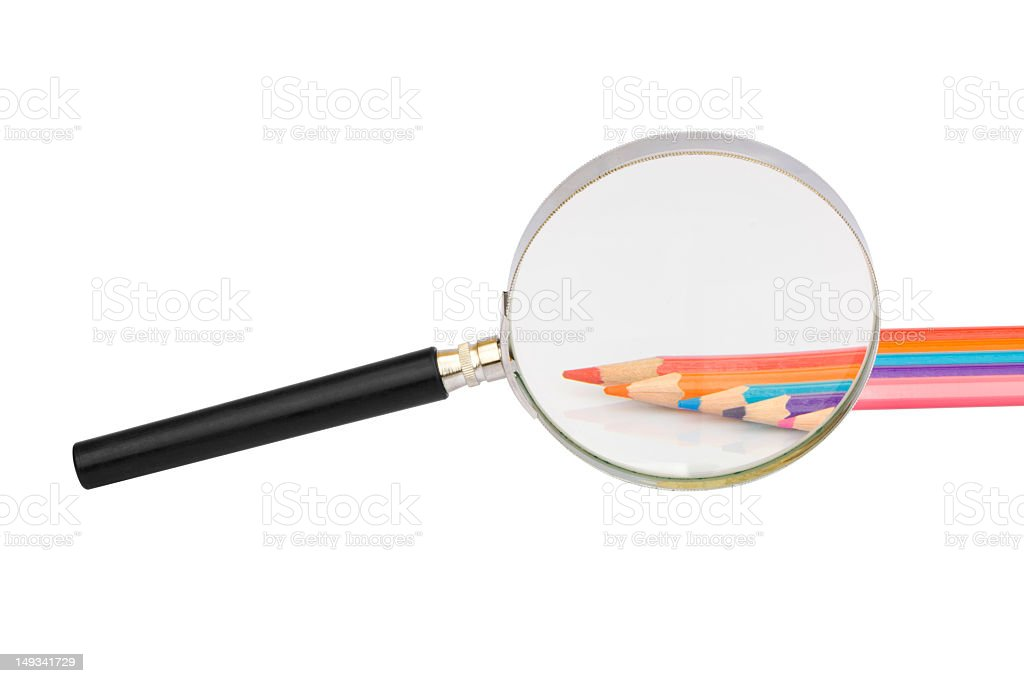 Color pens under magnifying glass royalty-free stock photo