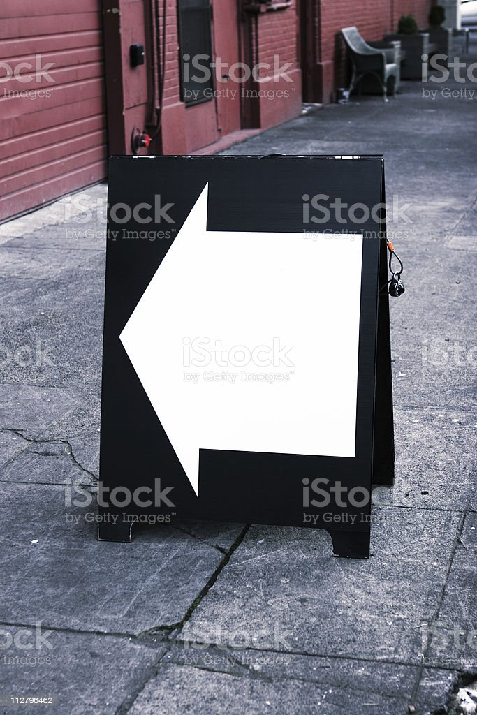 Color photo black and white arrow on sandwich sign board royalty-free stock photo