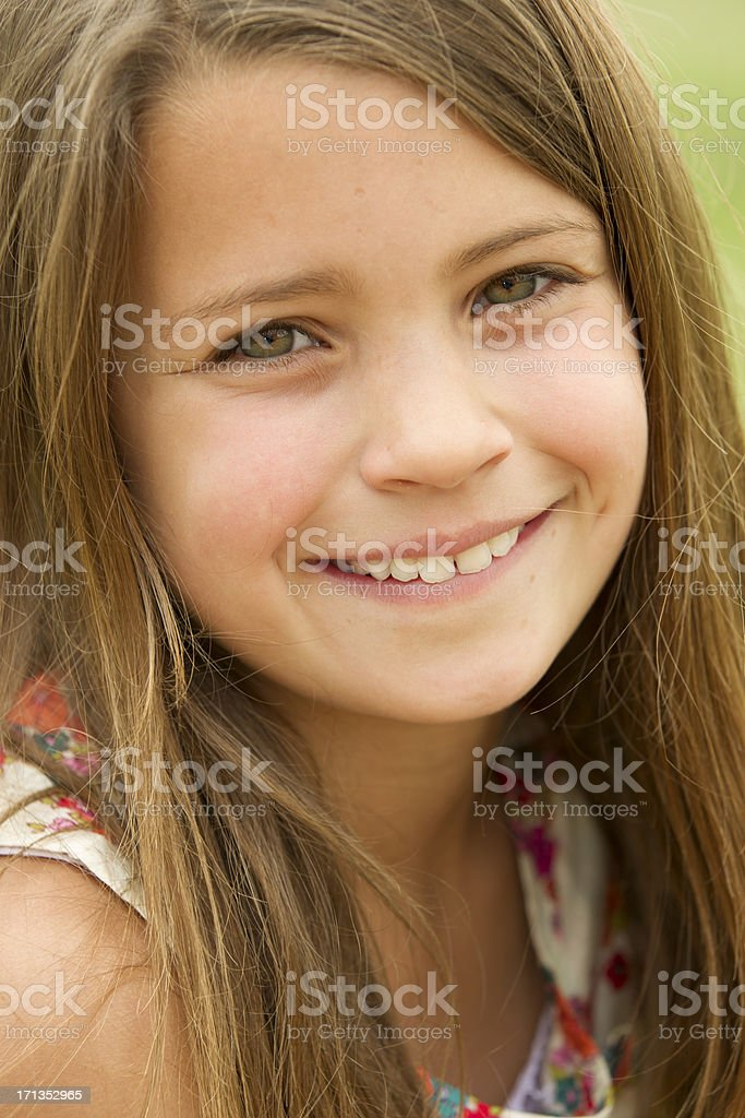 Color photo of a happy young girl laughing outside royalty-free stock photo