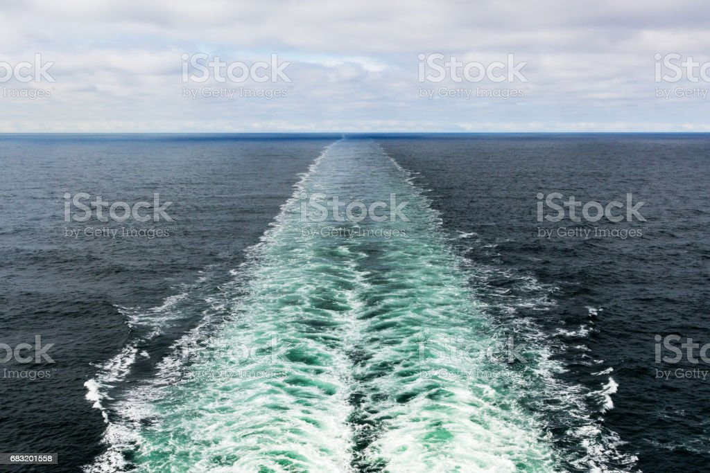 A color photo of cruise ship's wake. This image can be used as a background. stock photo