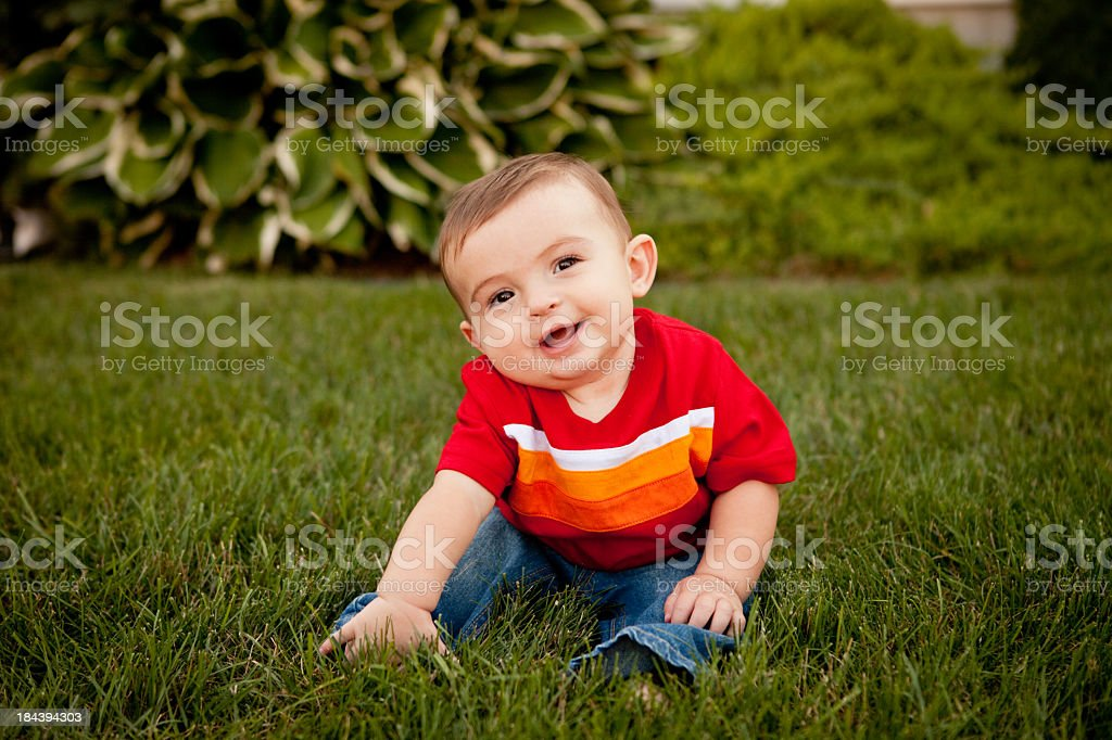 Color Photo of Happy Baby Boy Smiling in Outdoor Setting stock photo