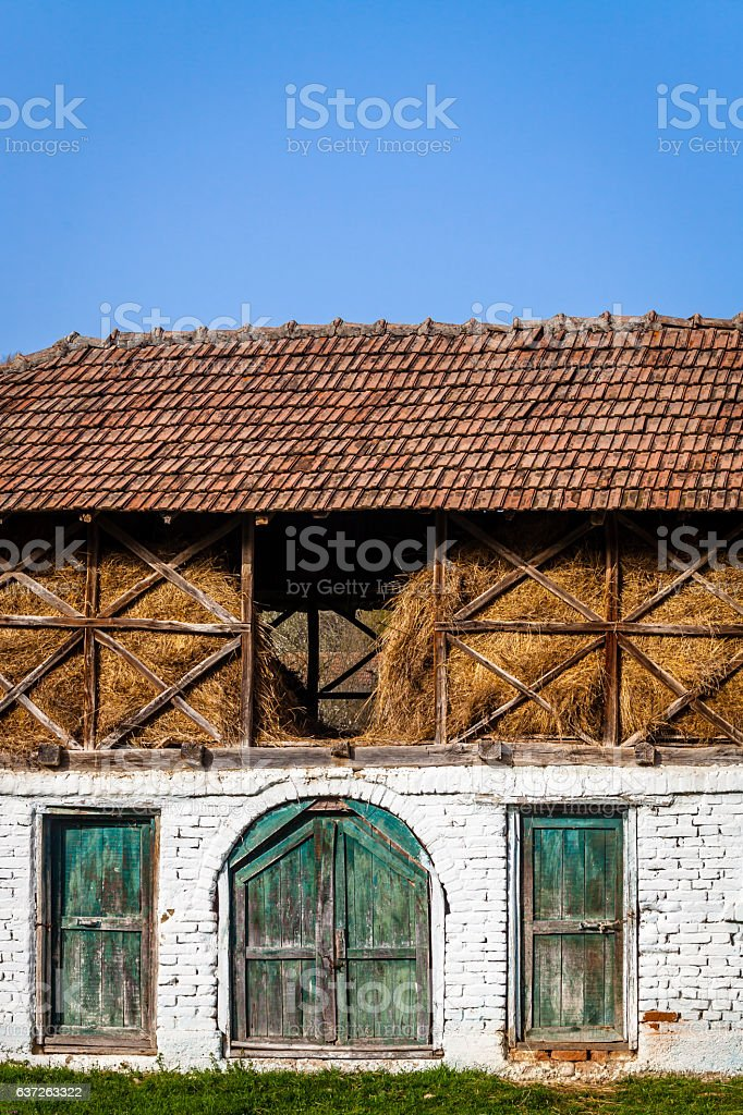 Color picture of a countryside animals shelter with haystack loft stock photo