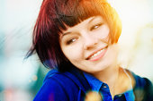 Color portrait of a charming and laughing girl