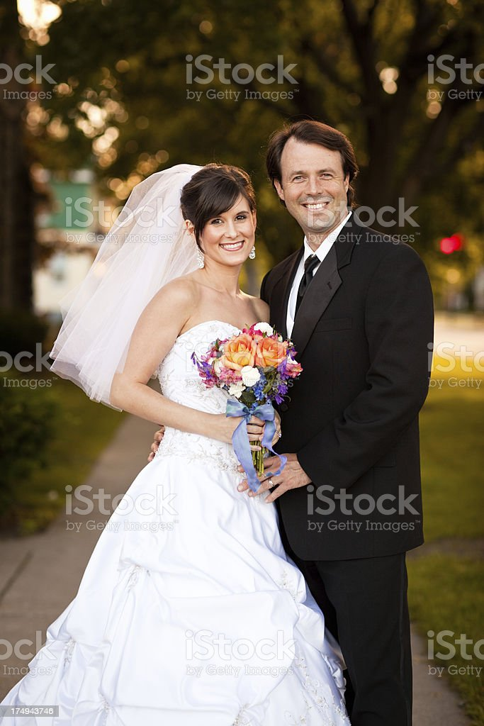 Color Portrait of Bride and Groom Standing Outside royalty-free stock photo