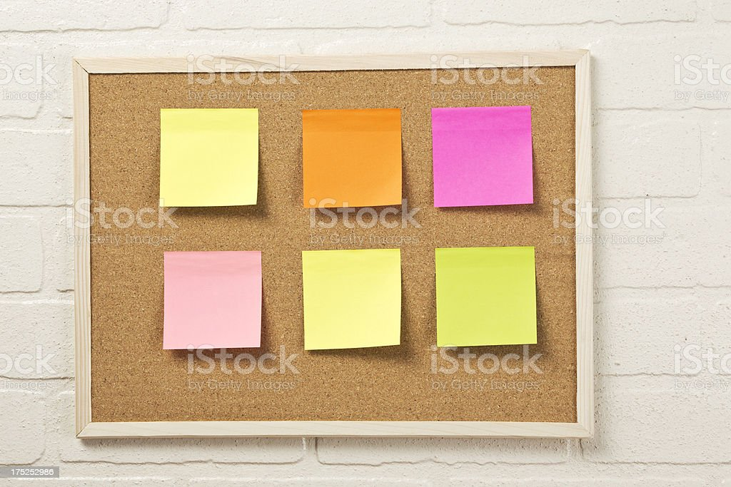color post it on cork board royalty-free stock photo