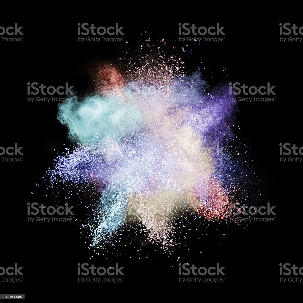Color powder explosion isolated on black stock photo
