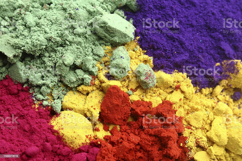 Color powders in green, blue, yellow, magenta and red stock photo