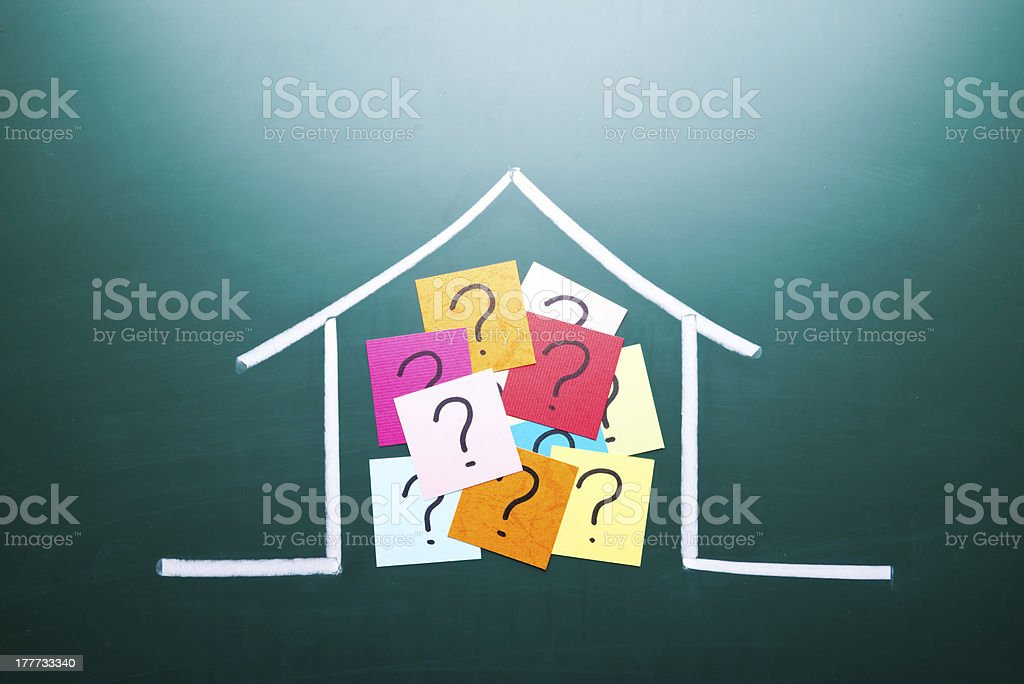 Color question mark in drawing house stock photo