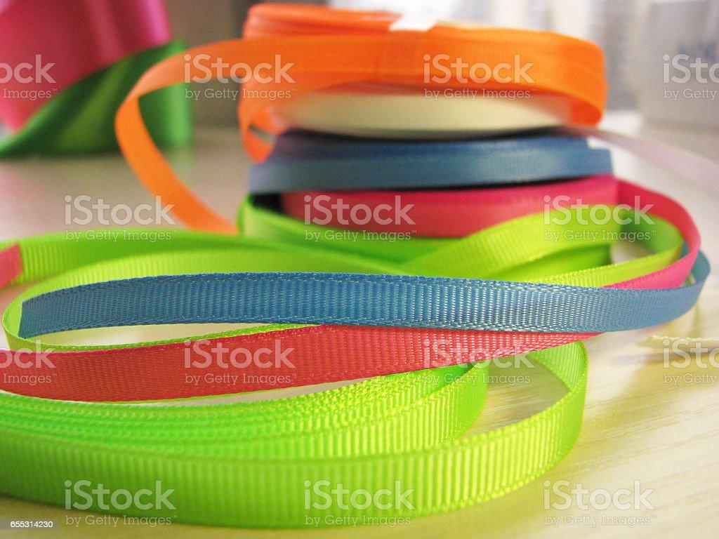 Color ribbon coils stock photo