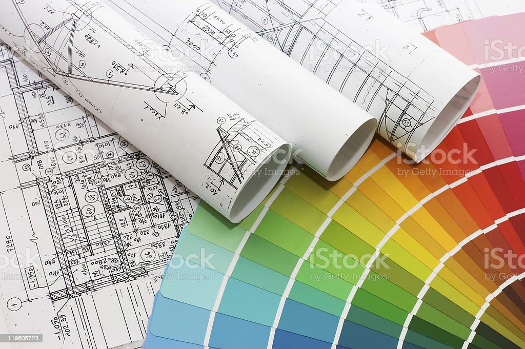 A color sample wheel next to blue prints royalty-free stock photo