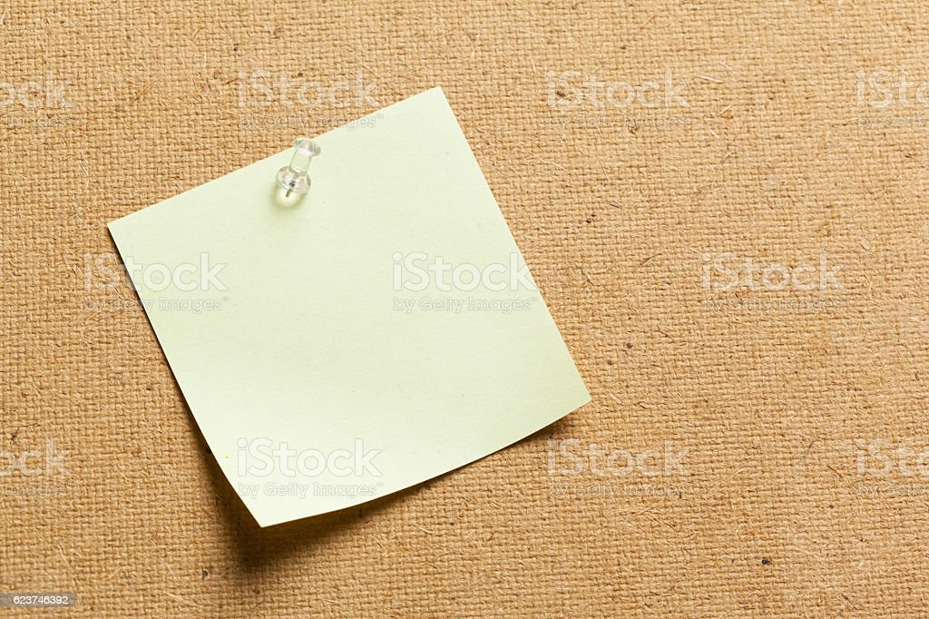 Color sticker notes over cork board background stock photo