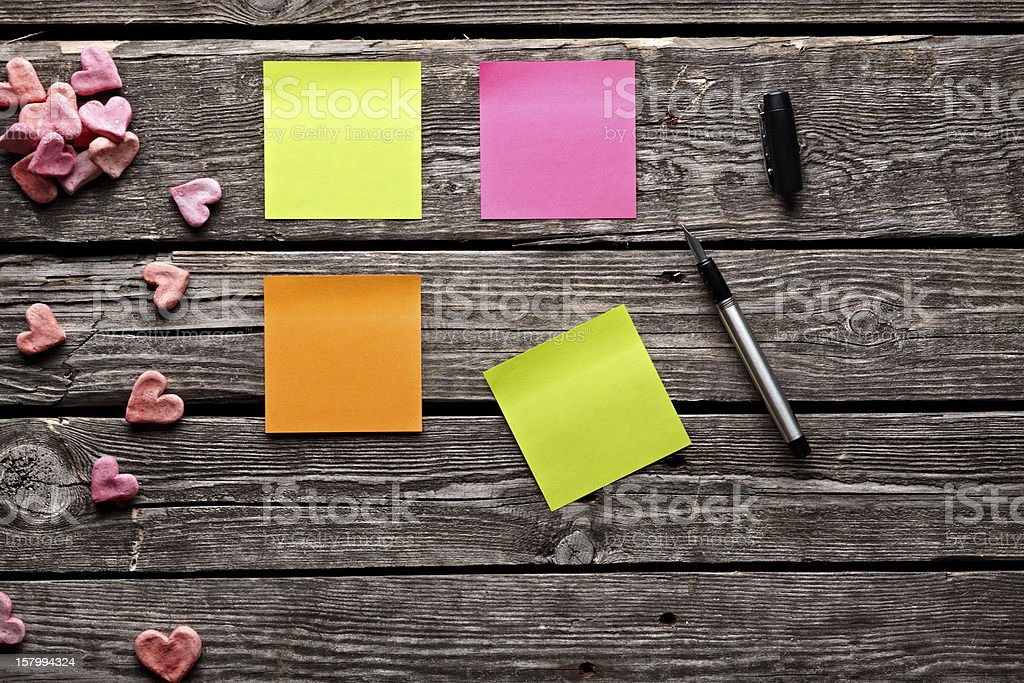 Color sticky note paper sheets with fountain pen royalty-free stock photo