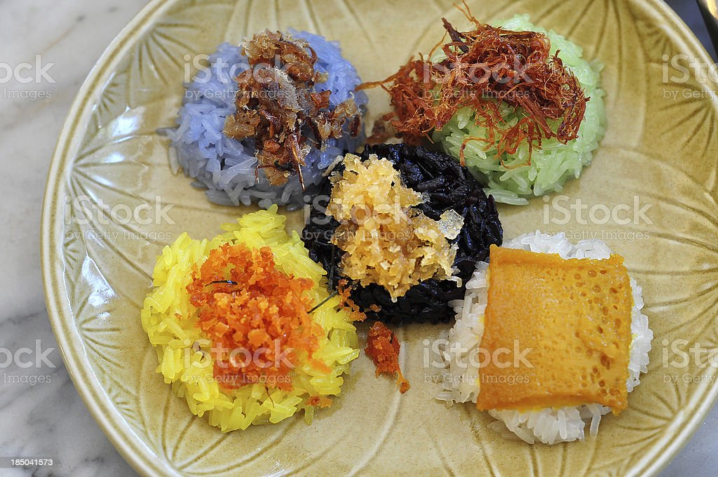 5 color sticky rice served with difference tops, famous Thai royalty-free stock photo