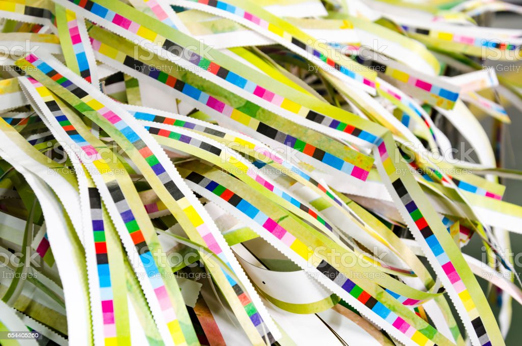 CMYK color stripes cut on printed paper stock photo
