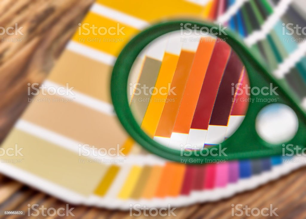 color swatch book under a magnifying glass stock photo