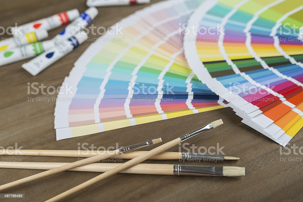 color swatch, brushes and tubes stock photo