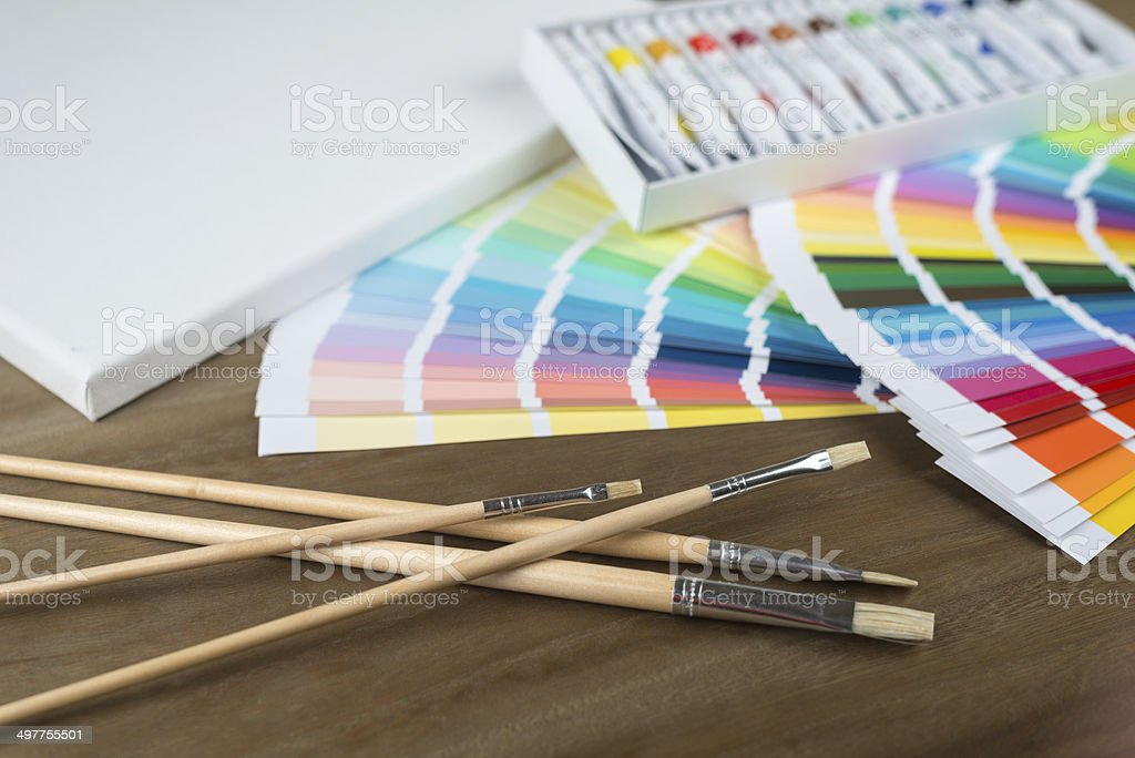 color swatch, brushes, canvas and tubes stock photo