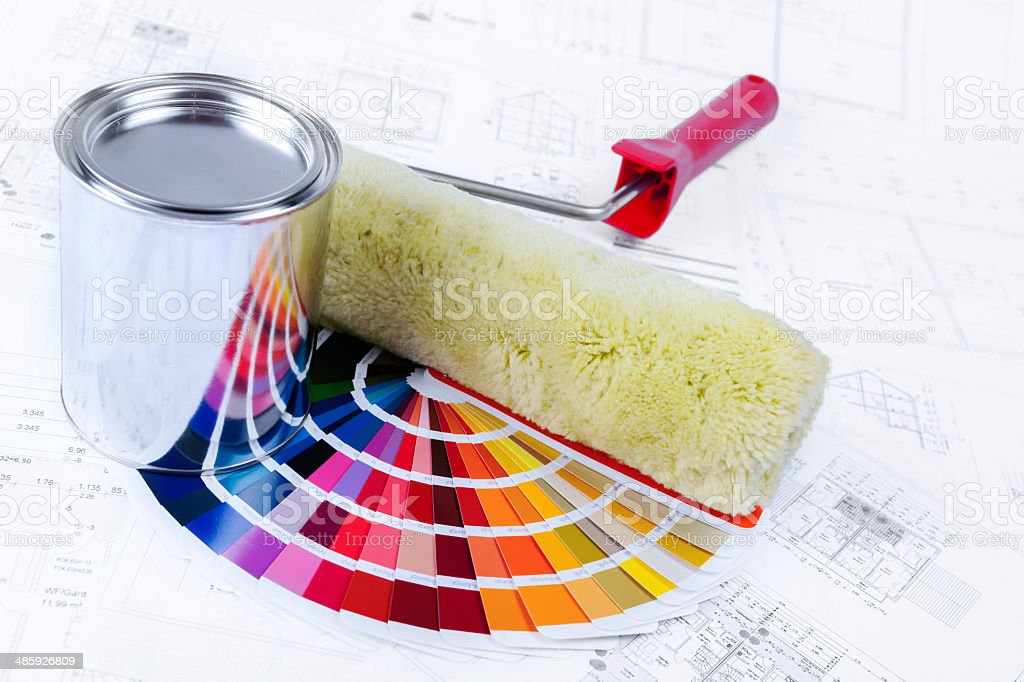 Color Swatch for home improvement blueprints and paintbrush stock photo