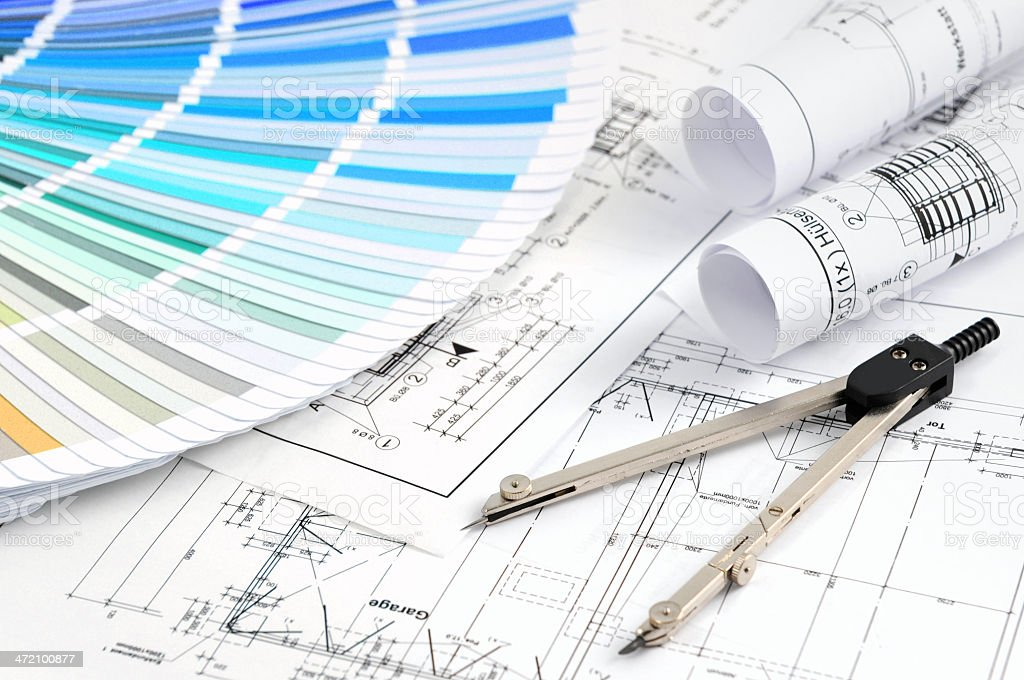 Color Swatch for home improvement with blueprints and drawing compass stock photo