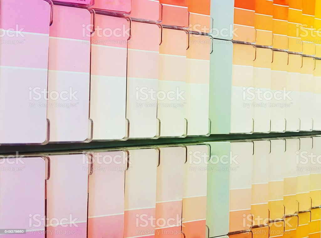 Color swatches in a paint store make ribbons of shades stock photo