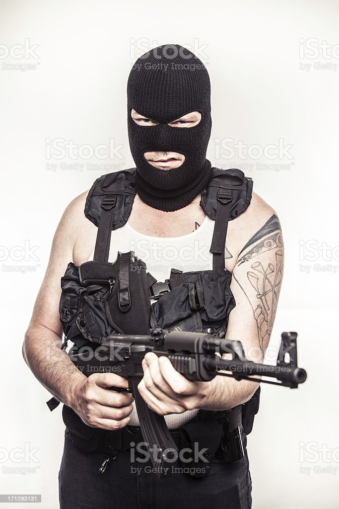 Color Terrorist Wielding a Machine Gun AK47 into Camera stock photo