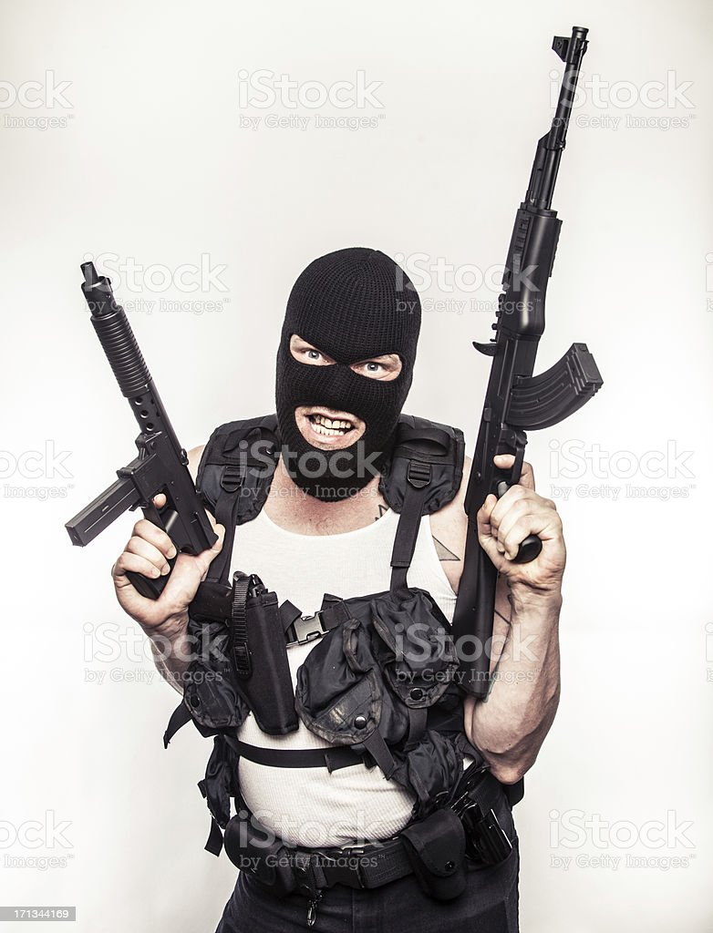 Color Terrorist Wielding Machine Guns Ski Mask Funny Pose stock photo
