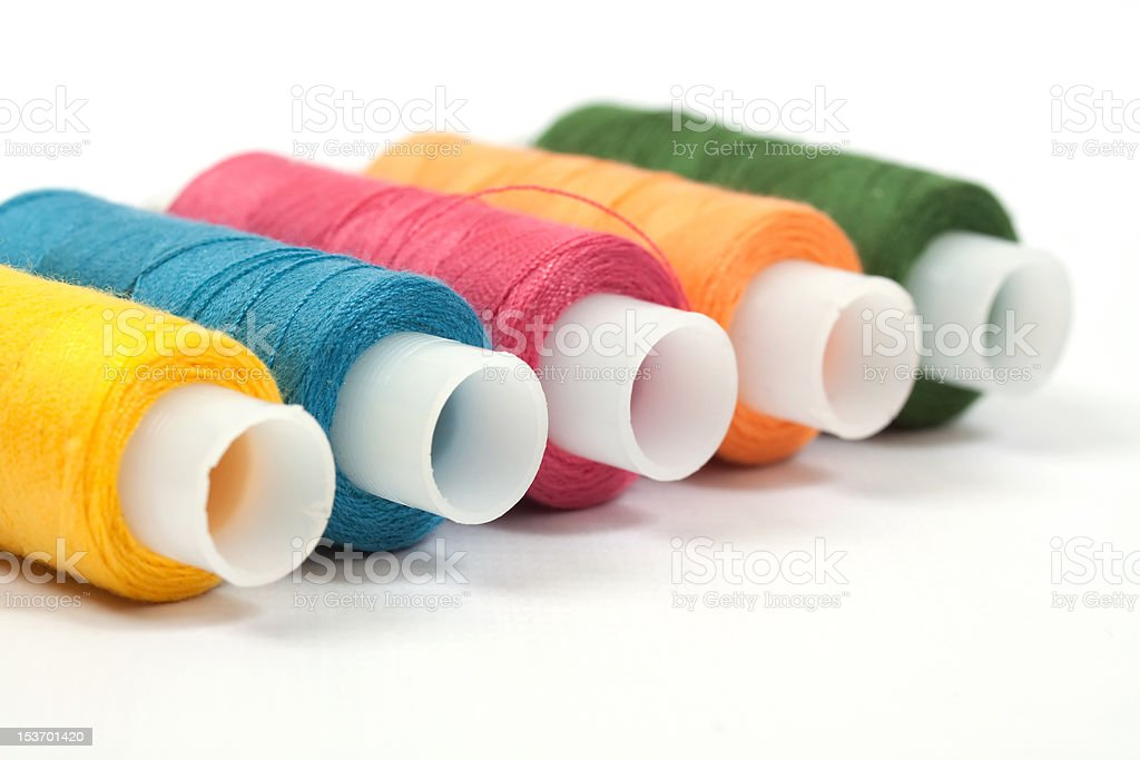 Color thread reels over white background royalty-free stock photo