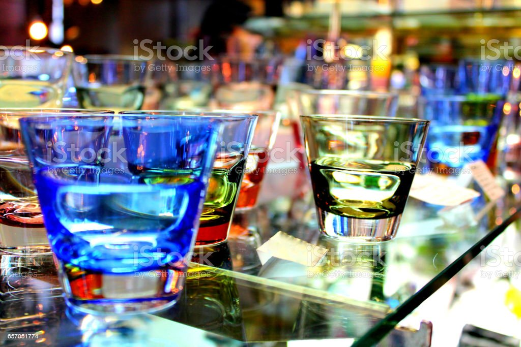 Color tinted drinking glasses stock photo
