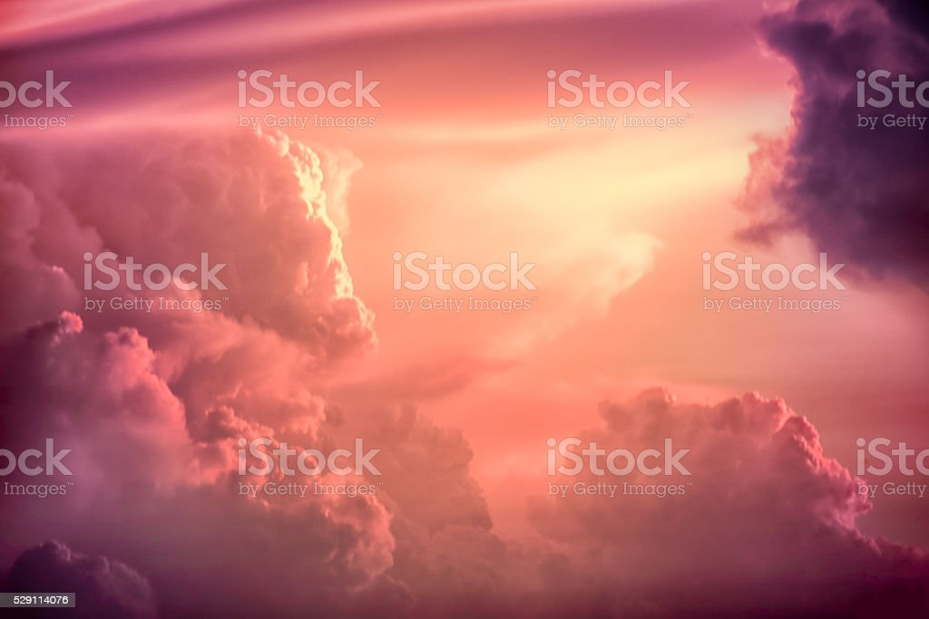 Color toned image,Dramatic sunset sky with colorful clouds. stock photo
