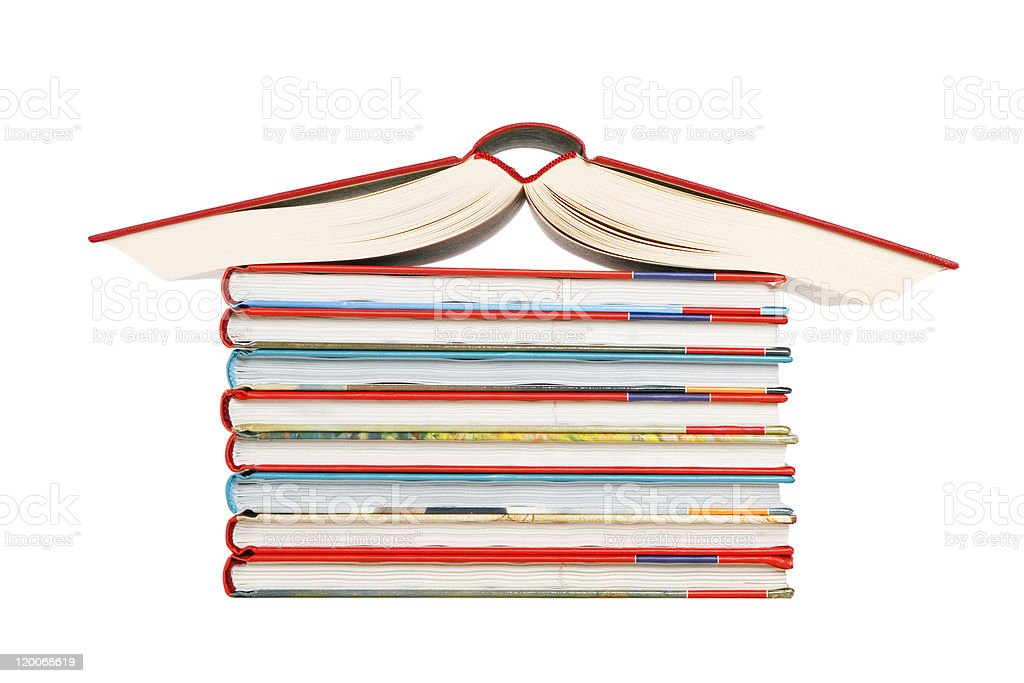 color tower books arranged in house shape royalty-free stock photo