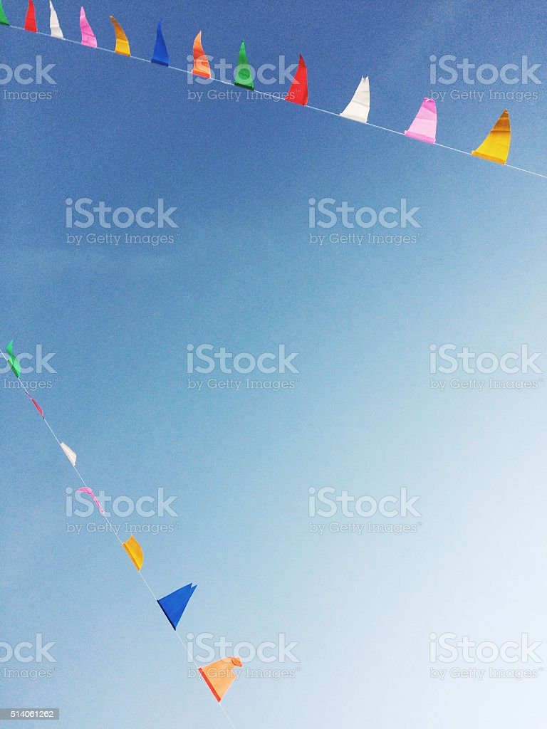 Color triangles flags in the sky stock photo