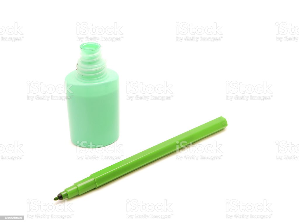 Color tube with paint and felt-tip pen royalty-free stock photo