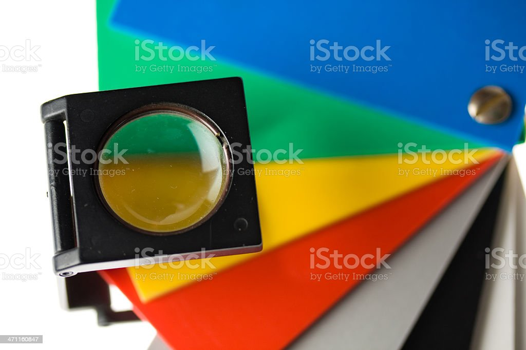 Color wheel and magnifying glass stock photo