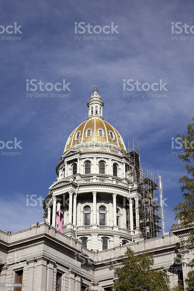 Colorado Capitol Building Dome repair scaffolding and construction vertical stock photo