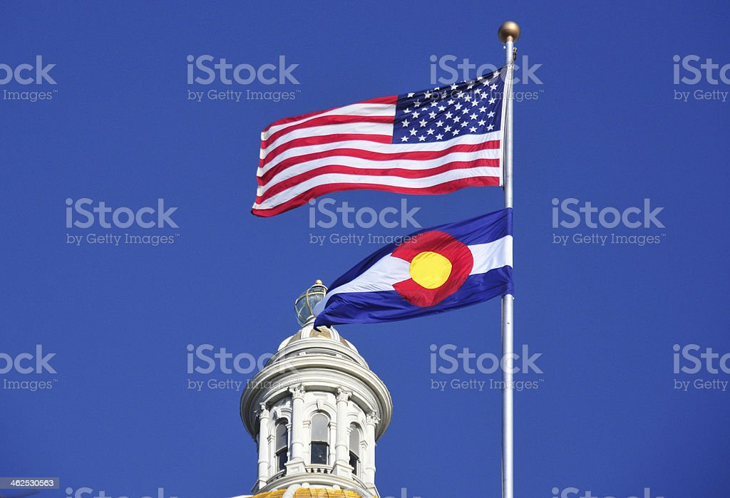 Colorado Capitol - state and US flags stock photo
