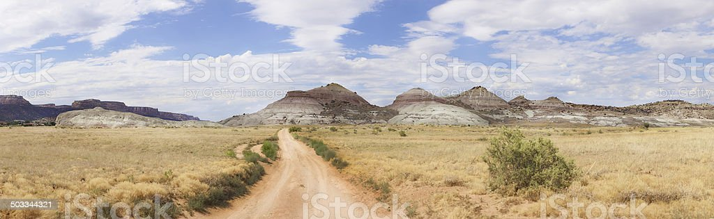 Colorado desert dirt road panorama sedimentary outcroppings royalty-free stock photo