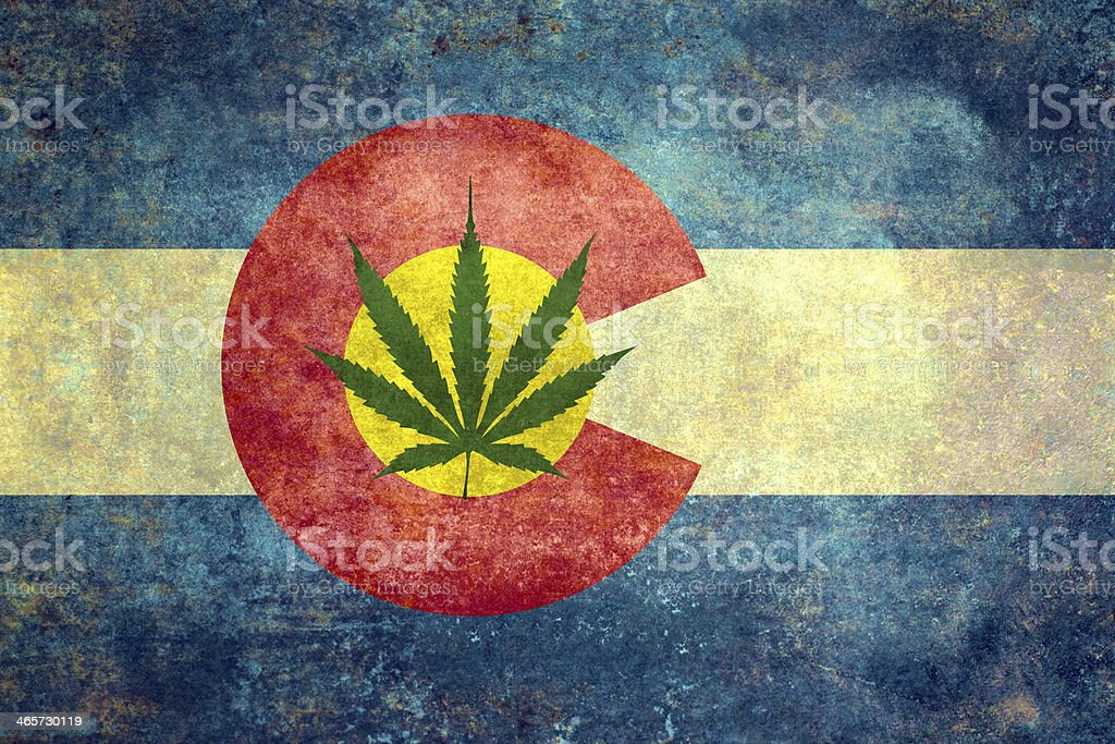 Colorado flag with cannabis leaf - controversial stock photo