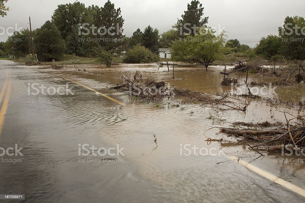 Colorado flooding road and home copy space stock photo