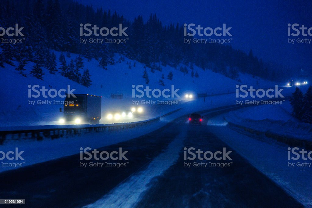 Colorado Interstate 70 Rocky Mountains Snow Blizzard Night Traffic stock photo