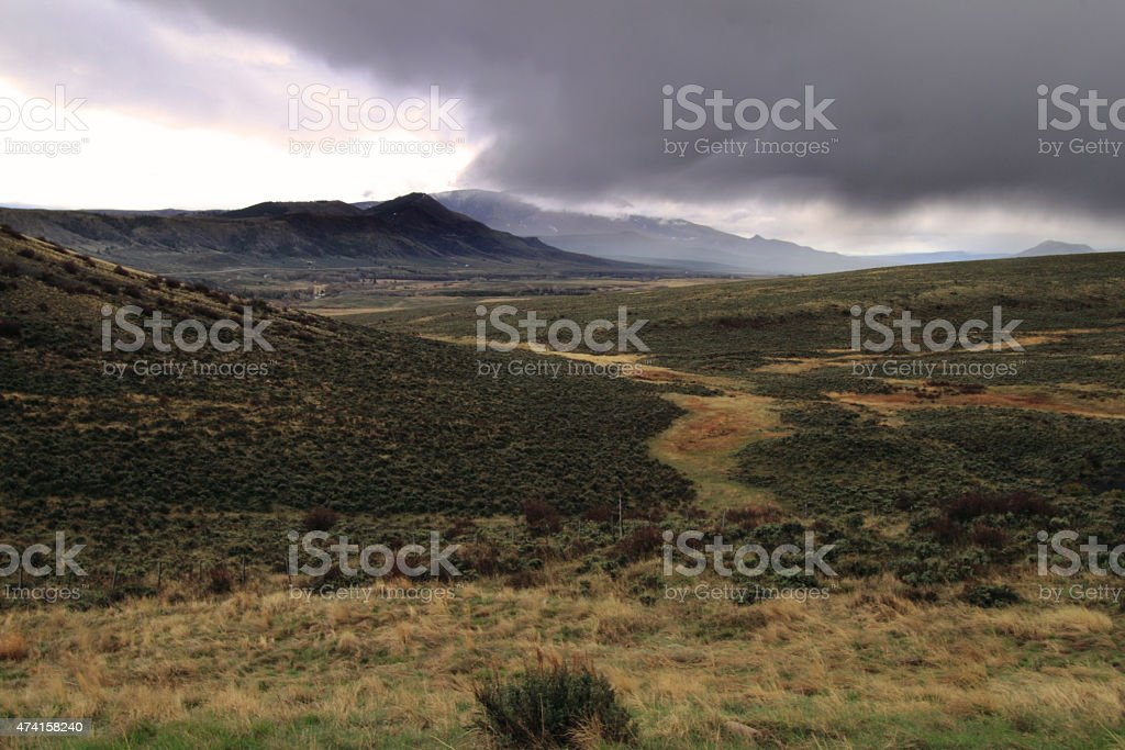 A sweeping view of rolling hills in the mountains of Colorado. This...