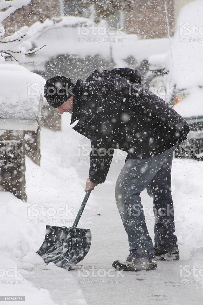 Colorado Snow & Man Shoveling on Sidewalk stock photo
