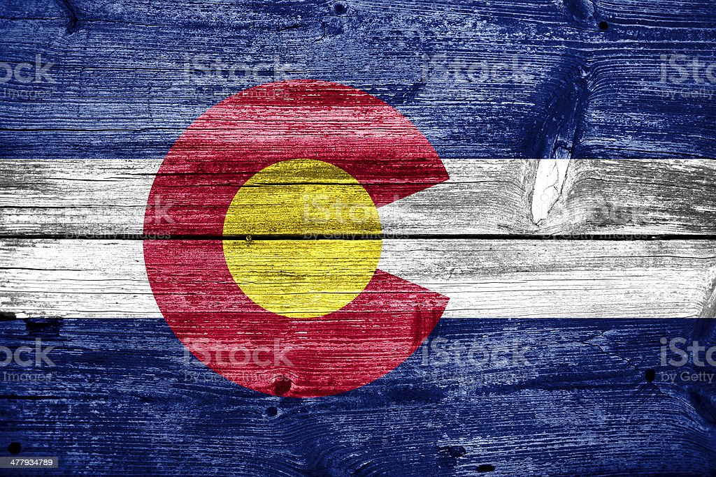 Colorado State Flag painted on old wood plank texture stock photo
