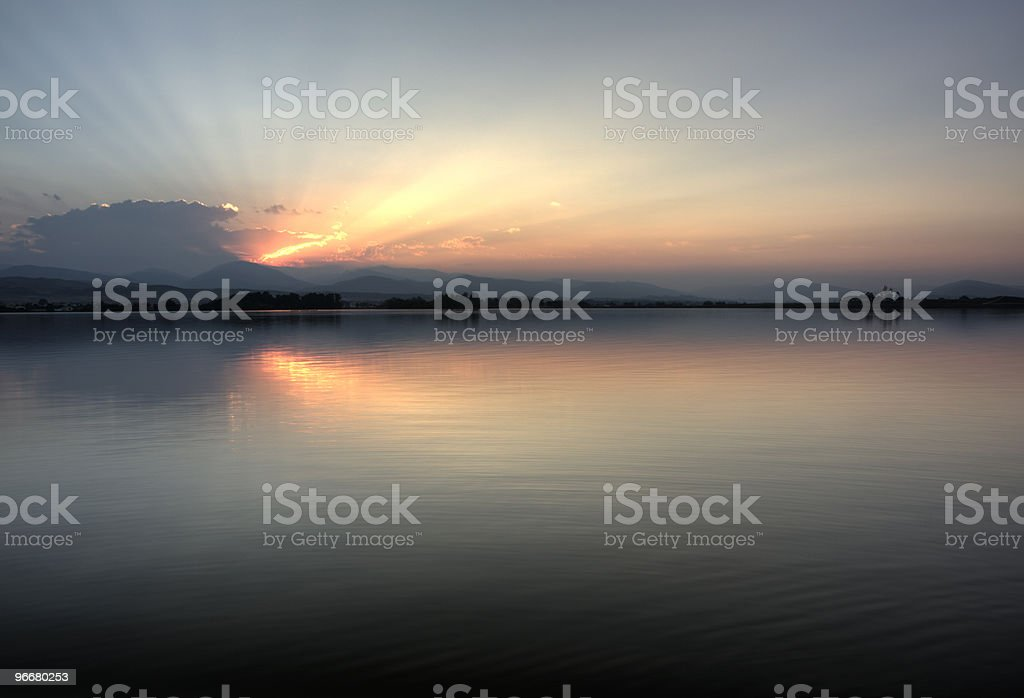 Colorado sunset over Rocky Mountains and a calm lake royalty-free stock photo