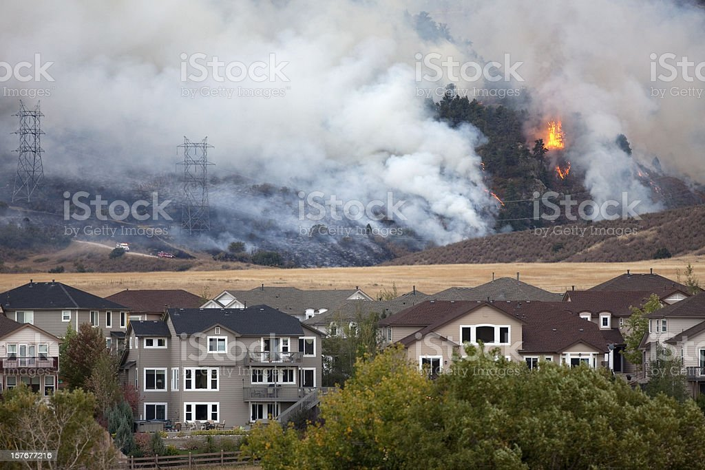 Colorado wild fire burns behind homes stock photo