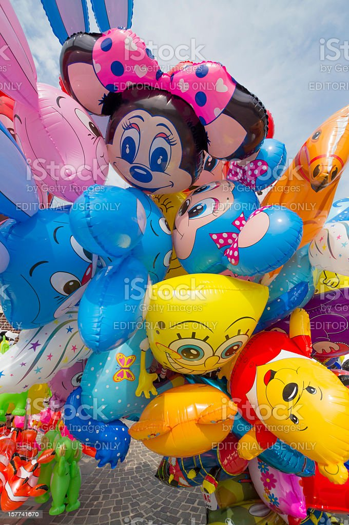 Colored air balloons for sale by a street market stalls stock photo