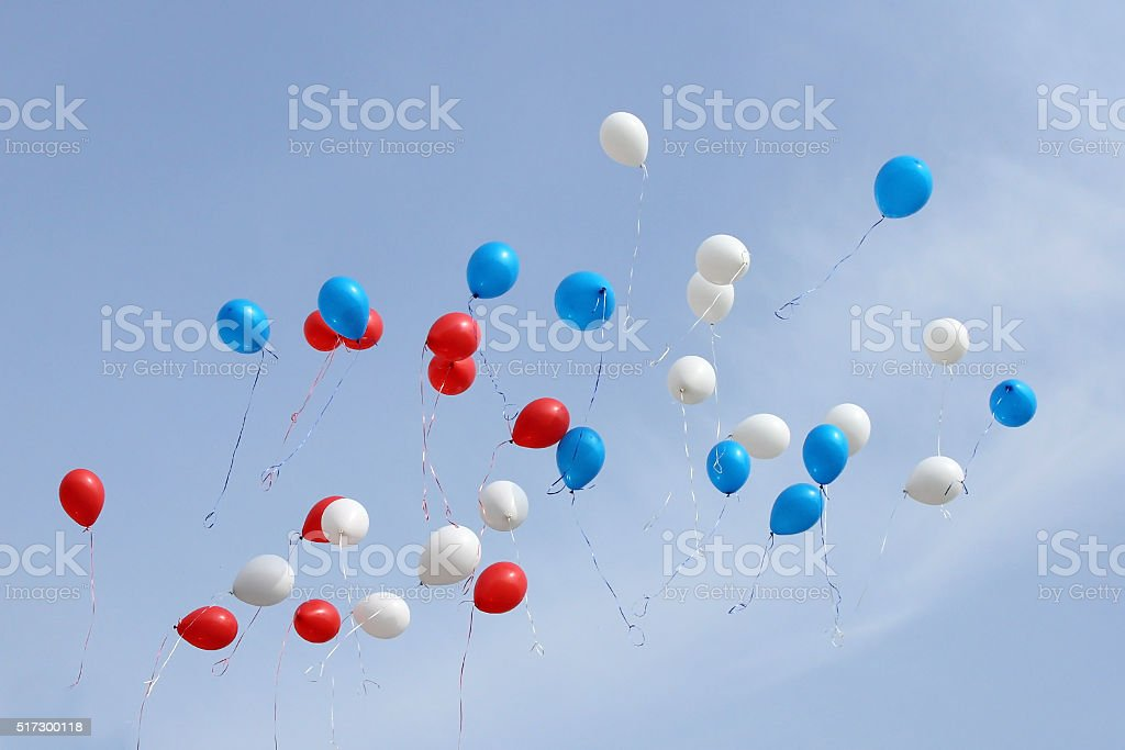 colored balloons on sky stock photo