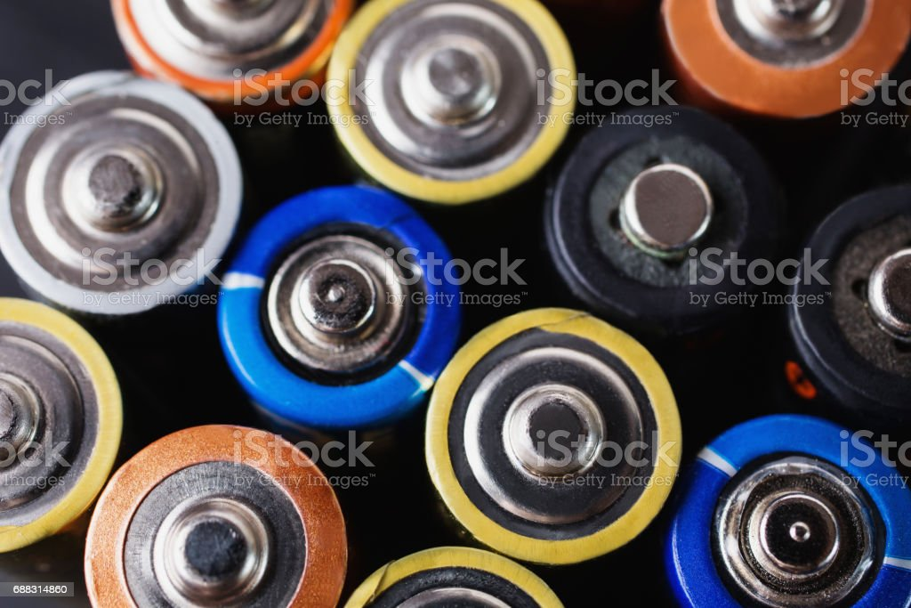 Colored batteries close-up. To save energy. AA alkaline batteries stock photo
