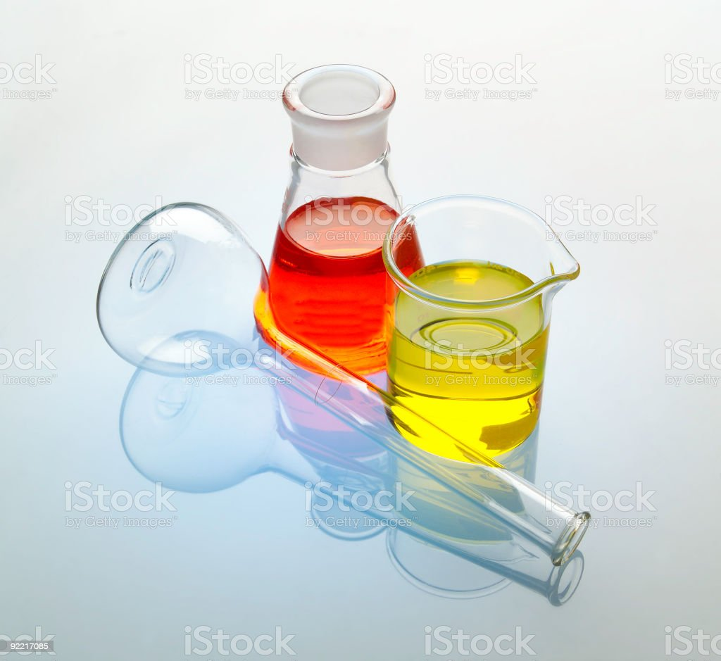 Colored beakers on white royalty-free stock photo
