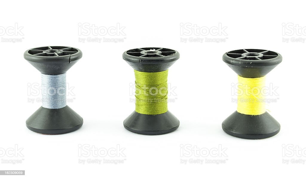 colored bobbins of silk threads on a coils isolated royalty-free stock photo